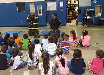 Firemen giving demonstration at Horizon School