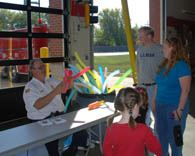 Chaplain Dominowski Making Balloon Animals